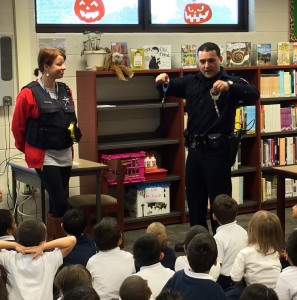 -Officer Cavada displaying handcuffs to Ms. Patty Northcutt and her students at Roy School during a safety speech-